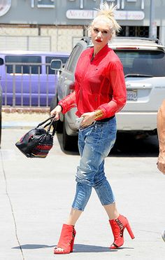 Gwen Stefani was red-hot in a mesh track jacket and open-toed booties while out and about in L.A. That bag is amazing!