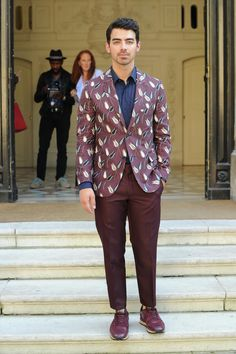 Joe Jonas wore a Valentino dress from the Spring/Summer 2015 collection and a pair of Valentino Garavani Rockrunner sneakers from the Fall/Winter 15/16 collection to attend the Men's Spring/Summer 2016 show.