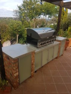 Bbq station..... yes!! time for some grilling. Whitewash bricks with concrete countertop and frosted glass cabinets