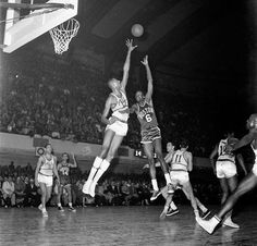 Boston Celtics center Bill Russell shoots over the reach of Philadelphia Warriors center Wilt Chamberlain during a game in 1960 at Convention Hall in Philadelphia. Hall of Famer Bill Russell, a five-time MVP, 12-time All-Star and winner of 11 NBA Championships, turns 80 today. (Neil Leifer/SI) GALLERY: Rare Photos of Bill Russell
