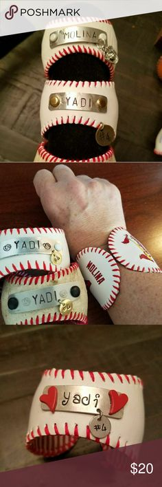 St Louis Cardinals Yadi Molina Baseball Bracelet Handmade by me from a repurposed vintage baseball. Hand stamped with Yadi or Molina on an aluminum plate with his number hanging from the plate. Adjustable to fit all wrist sizes. Repurposed men's dress shirt material covers the inside of the band. Visit my page at www.etsy.com/shop/uniquelynataliedsign to see other styles available and to save on shipping. If you order from here,  specify which design you want.  Note these are all sold and…