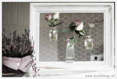 Chicken wire rustic frame with flowers in funky glass vases