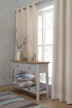 Natural and simple Delicate Weave Eyelet Curtains from Next are ideal for our living room