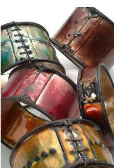 Kate Cathey, Artist, enameled copper bracelets.   Love the warrior chick vibe