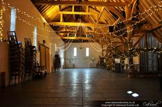 Simple star of fairy lights in the barn at Ufton Court for an August wedding
