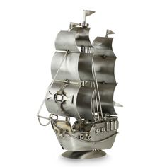 Features:  -Material: Recycled metal.  -Rustic galleon.  -Components may vary slightly in size and form.  -Rustic, rugged finish.  Product Type: -Model boat/Car/Plane.  Style: -Modern.  Theme: -Travel