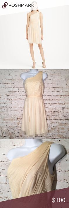 """J CREW Silk Kylie One Shoulder Bridesmaid Dress Sheer perfection in whispery-soft crinkled silk chiffon, this modern one-shoulder silhouette is balanced with a flouncy party-perfect skirt.  Color: Champagne. Silk chiffon. Side zip. Lined. Dry clean. A-line silhouette. Fitted bodice. Falls just above knee. Brand new with tags.  Approximate Measurements: (all measurements are taken laying flat and unstretched)  Chest (Armpit to Armpit): 17.5"""" Waist: 16"""" Length (from armpit): 29"""" Length (from…"""