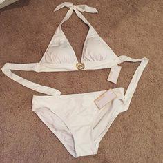Michael Kors White Bikini Top & Bottom Michael Kors White Tie up Halter Bikini Top and bottoms Size Med New Never Worn MICHAEL Michael Kors Swim Bikinis