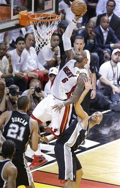 The San Antonio Spurs' Tony Parker (9) moves out of the way pf Miami Heat's LeBron James (6) during the first half in Game 7 of the NBA basketball championships, Thursday, June 20, 2013, in Miami