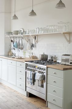 Love the countertop, open shelves and lights.