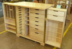 STORAGE WORKSPACE CABINET: the two sides, attached with piano hinges for strength, open up to…. 24 drawers for stamps, paper, embellishments or punches; the larger bottom drawer on right holds a Big Shot! The right wing has 2 more drawers for re-inkers