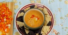 SLOW COOKER QUESO DIP  Serves 8  Ingredients  2 pounds cheddar cheese, cubed 1 pound ground beef 1 (10 oz.) can fire-roasted tomatoes 1 (10 oz.) can diced tomatoes and green peppers 1 (7 oz.) can green chiles 1/2 (8 oz.) package cream cheese, softened  Cook in crock pot on high for 2 hours. Serve with chips.