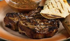This spicy steak recipe from Steven Raichlen It comes from an unassuming steak house in Jaurez, Mexico, called Mitla. It's served with salsa and tortillas.