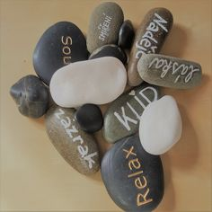 Stones representing positive things in life for sandtray therapy.
