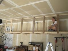 Build overhead hanging storage in your garage. You can do it! Tutorial.