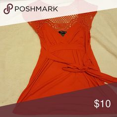 Orange top sz m Orange Shirt with see through shoulders and back. Accent line below the breast, and a a tie which you can tie in the front or back Other