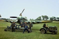 Ground staff prepare to load a Hawker Typhoon with bombs. Typhoons received striped markings as of December as their silhouette from the top and bottom was easily confused with that of So not Invasion stripes. This photo is probably Ww2 Aircraft, Fighter Aircraft, Aircraft Carrier, Military Jets, Military Aircraft, Hawker Tempest, Hawker Typhoon, Ww2 Pictures, Stock Pictures