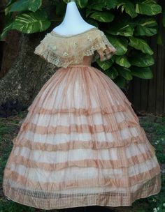 Pink silk gauze ballgown shown with an original tulle and lace bertha