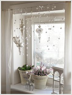 Silvery ornaments in the window