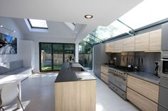 Structural glass strip roof light with glass beams and aluminium bi fold doors to rear extension Glass Extension, Roof Extension, Extension Ideas, Aluminium Windows And Doors, Glass And Aluminium, Side Return Extension, Elegant Kitchens, Roof Light, Glass Roof