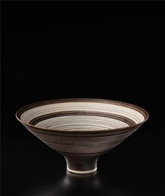 Large open bowl, Porcelain, manganese glaze, sgraffito and inlaid designs of concentric rings and bands repeated inside and out. 10 1/4 in. (26 cm.) diameter, c.1978