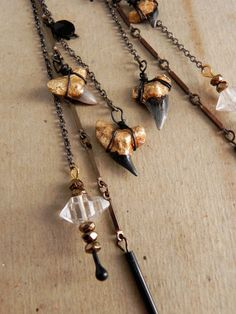 Unda. the Bride of the Sea... herkimer diamond and gilded shark tooth earrings.
