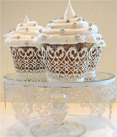 VINTAGE THEME - thinking cupcakes for your big day but still want a vintage look?  get lace look cupcake holders and use edible decorative toppers.