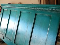 Headboard made from an old door and crown molding/would like to build this only in an antique white finish.