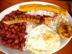 Bandeja Paisa, a meal popular in parts of Colombia, includes:  Red beans, white rice, fried egg, sausage, chicharon, sliced avocado, fried banana, arepa (flat bread made from cornmeal). (photo by The MapMakers - Mike) - food - South America