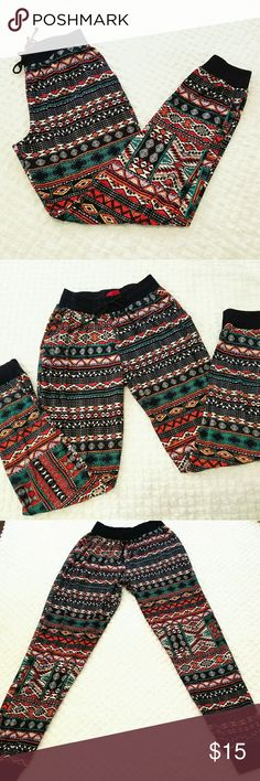 $6 If Bundled Tribal Print Joggers Size Small These sweat pants/joggers are in excellent used condition, size small. Just wore these a couple times. Vibrant tribal print really stands out. From a smoke-free home!   **Must be bundled with one or more items with  to receive discount** Otherwise, price is firm. Pants Track Pants & Joggers