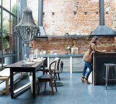 brick and those amazing oversized antique light fittings