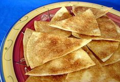 Cinnamon Tortilla Chips:  1 (24 ounce) package flour tortillas   butter (melted)   cinnamon sugar    1. Brush butter over the entire top of one tortilla.  2.Sprinkle generously with cinnamon sugar.  3. Cut into 8ths.  4. Put onto a cookie sheet and bake at 350 degrees till light brown (not to dark).  5. Approximately 8 to 10 minutes.