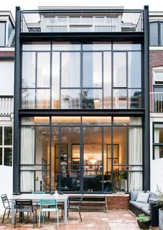 Completed in 2015 in Utrecht, The Netherlands. Images by Suzanne Paap . Dutch design studio Lab-S has renovated a row house in the city of Utrecht (the Netherlands) and added a contemporary two story extension in. Facade Architecture, Residential Architecture, Townhouse Exterior, Glass Facades, House Extensions, Industrial House, Facade House, Window Design, Glass House