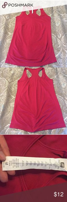 Red/pink medium Fabletics Oula tank top GUC Bought this on posh it's too big for me. GUC in a berry like color. Has some minor pilling under the arm area and a snag in the chest area. Also listed the blue one like it separate or 2 for $20 OBO Fabletics Tops Tank Tops