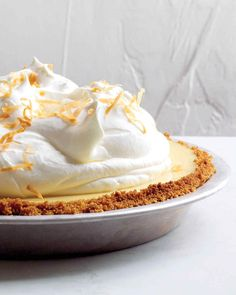 """A classic Key lime pie gets upgraded.with coconut milk in the filling [and] the dessert is gilded with toasted shredded coconut sprinkled on top of a billowy whipped cream topping -- Coconut-Key Lime Pie Recipe"". Yes, that is right: gilded and billowy. Coconut Key Lime Pie Recipe, Keylime Pie Recipe, Recipe Key, Recipe Image, Recipe Notes, Beaux Desserts, Just Desserts, Delicious Desserts, Easter Desserts"