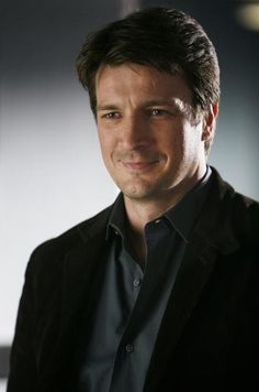 Nathan Fillian (Rick Castle) from Castle, is my favorite on TV.  Love his His character's humor, caring attitude, lack of anger, all of him.  I would like someone like him for a husband.