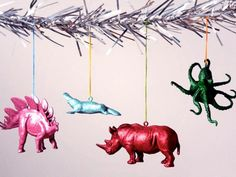 Recycle old plastic toy animals or buy new ones to create a Christmas menagerie. These are so easy to make, the kids can help. An eye hook is inserted into the top of the animal, then a fresh coat of paint and a coat of glitter are added. Design by Curbly.