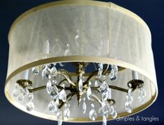 DIY Drum Shade. heavier fabric with interfacing or plexiglass for sturdiness to cover an ugly chandelier (renter friendly).