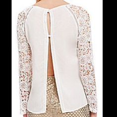 Chelsea & Violet Lace sleeve blouse Chelsea & Violet Lace Sleeve blouse with split in back, floral lace sleeves, color white, size medium. great with jean and heels FINAL REDUCTION Chelsea & Violet Tops Blouses