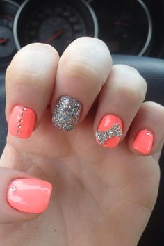 Coral, silver glitter, rhinestones and bow.