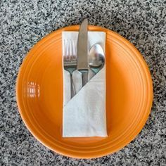 Good site that has quite a few step by step pictorial instructions on how to fold napkins.