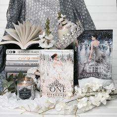 Today for #bookishscavengerhunt17 the theme is dress on cover and I dont know about you but the first series I think of when it comes to girls in pretty dresses is the Selection Series by @kieracass!!!! . I know they arent really as popular anymore but I still a pretty cover with a girl in a pretty dress !!! What is one of your favorite pretty dress covers??? . The candles are from @acourtofcandles use code Faerie for a 20% discount!!! . The scarf was included in a past @fairyloot box…