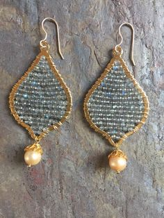 A personal favorite from my Etsy shop https://www.etsy.com/listing/478684668/gold-hoop-statement-earrings-with