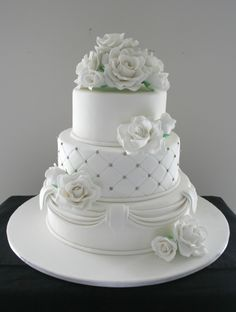 Beautiful wedding cake.  I'm not usually a fan of draping, but this is exceptional.