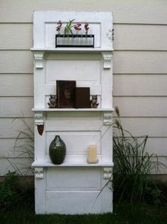 Turn an old door into shelves or a bookcase. by Staci21*