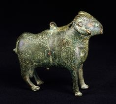 Figure in the form of a ram, cast and engraved bronze Iran; 12th-13th century H: 13.3; L: 14.5 cm
