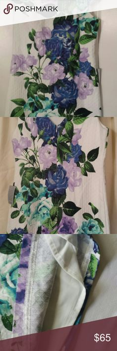 Dress Cap sleeve, mid length floral off white with lavender and blue flowers, accented with green leaves , and fully lined. Eliza J Dresses