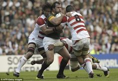 South Africa's hooker Bismarck du Plessis is tackled by Japan's back row Hendrik Tui. RWC 2015.