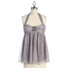 Hazel for Anthropologie Purple Halter Top Purple halter top with delicate flower pattern. Fabric has a natural crinkled texture to it. Empire style, with fitted top and flow-y bottom. Some beading on the bodice. Worn twice. Anthropologie Tops Tank Tops