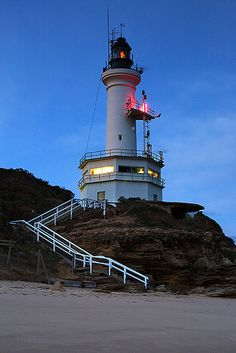"""Point Lonsdale Lighthouse is located close to the township of Point Lonsdale, in the Borough of Queenscliffe, Victoria, Australia. It stands on a headland overlooking the """"Rip"""", a stretch of water considered one of the ten most treacherous navigable passages in the world, and the only seaborne approach to Melbourne, Australia. It is staffed 24 hours a day to control the movements of shipping making it the last manned lighthouse in Australia."""